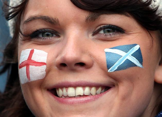 A rugby fan displays her face painted with the flags of Scotland and England ahead of the Six Nations rugby union international match between Scotland and England at Murrayfield, Edinburgh, Scotland,