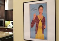 A framed image of comedian Gilda Radner hangs on the wall inside the cancer support group Gilda&#39;s Club Madison on Wednesday, Nov. 27, 2012, in Middleton, Wis. The Madison-area chapter of the national group is the latest to change its name to the Cancer Support Community, a move its director said was necessary because young people don&#39;t know who Radner was. (AP Photo/Scott Bauer)
