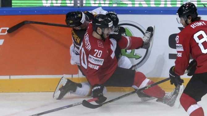 Switzerland's Hollenstein collides with Germany's Koppchen during their Ice Hockey World Championship game at the O2 arena in Prague