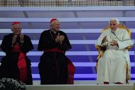 Pope Benedict XVI (R) delivers a speech during a meeting with families for the feast of testimonies at the park of Bresso as part of the 7th World Meeting of Families in Milan. Tens of thousands of young Catholics greeted Pope Benedict XVI in Italy's northern city of Milan on Saturday in a welcome distraction from Vatican infighting for the aged pontiff