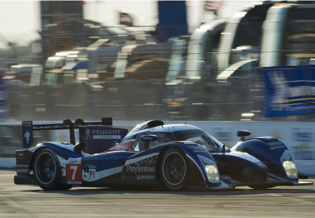 Peugeot Sport Total's Alexander Wurz, of Austria, accelerates the Audi 908 (7) out of Turn 1 before sunset during the 59th annual American Le Mans Series 12 Hours of Sebring auto race at the Sebring I