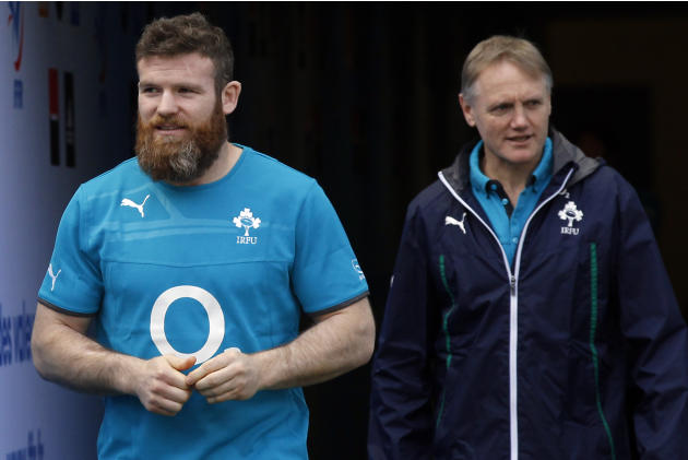 Ireland's Gordon D'Arcy, left, and team coach Joe Schmidt arrive for a training session at the Stade de France stadium, in Saint Denis, outside Paris, Friday, March 14, 2014. Ireland will play