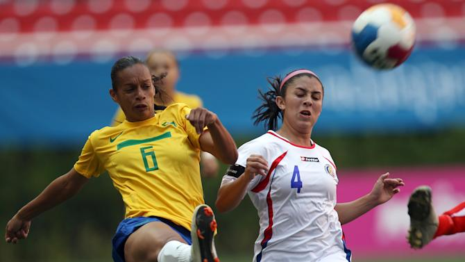 Chased by Costa Rica's Lixi Rodriguez, second from left, Brazil's Rosana Augusto, left, clears the ball during a women's soccer match at the Pan American Games in Guadalajara, Mexico, Thursday, Oct. 20, 2011. (AP Photo/Juan Karita)
