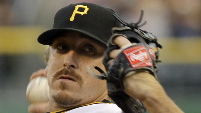 Pittsburgh Pirates pitcher Kevin Correia throws in the first inning of a baseball game against the Washington Nationals in Pittsburgh, Thursday, May 10, 2012. (AP Photo/Gene J. Puskar)