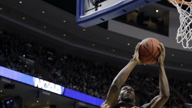 Cincinnati's Titus Rubles, right, goes up for a shot against Creighton's Doug McDermott during the first half of a second-round game of the NCAA college basketball tournament, Friday, March 22, 2013, in Philadelphia. (AP Photo/Matt Slocum)