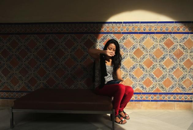 Japanese flamenco student Maika Kubo sits on a bench at the Museum of Arts and Traditions of Seville