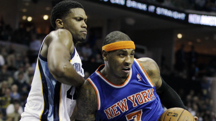 New York Knicks' Carmelo Anthony (7) pushes past Memphis Grizzlies' Rudy Gay during the first half of an NBA basketball game in Memphis, Tenn., Friday, Nov. 16, 2012. (AP Photo/Danny Johnston)