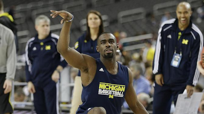 Michigan's Tim Hardaway Jr. dances on the floor during practice the NCAA Final Four tournament college basketball semifinal game against Syracuse, Friday, April 5, 2013, in Atlanta. Michigan plays Syracuse in a semifinal game on Saturday. (AP Photo/David J. Phillip)