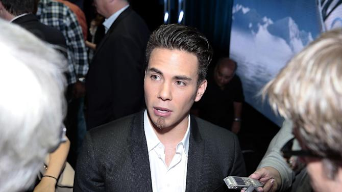 This publicity image released by NBC shows Apolo Ohno speaking to the media at the NBC Olympics session during the NBCUniversal Press Tour in Beverly Hills, Calif., on Saturday, July 27, 2013. (AP Photo/NBC, Chris Haston)