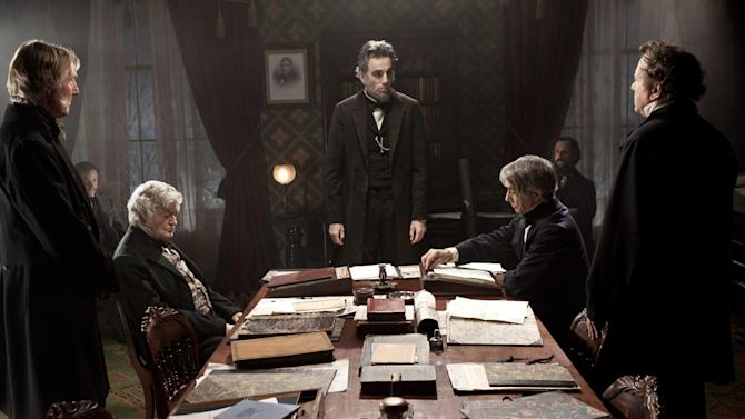 "FILE - This undated publicity photo released by DreamWorks and Twentieth Century Fox, shows Daniel Day-Lewis, center rear, as Abraham Lincoln, in a scene from the film, ""Lincoln.""  The historical drama earned a record-breaking 13 nominations for the Critics' Choice Movie Awards. The Broadcast Film Critics Association announced the nominees for its 18th annual awards ceremony Tuesday, Dec. 11, 2012, in Los Angeles.  (AP Photo/DreamWorks, Twentieth Century Fox, David James, File)"
