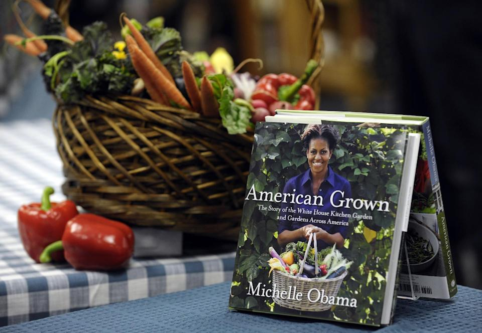 "Copies of the book by first lady Michelle Obama ""American Grown: The Story of the White House Kitchen Garden and Garden Across America,"" are on display at the Politics & Prose bookstore in Washington, Tuesday, May 7, 2013. Obama signed copies of her book. (AP Photo/Susan Walsh)"