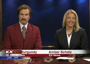 "In this screen grab provided by television station KXMB, Will Ferrell, as his ""Anchorman"" character Ron Burgundy, co-anchors the evening news with Amber Schatz, Saturday, Nov. 30, 2013, in Bismarck, N.D. The surprise appearance was part of the promotional tour for the movie ""Anchorman 2: The Legend Continues."" (AP Photo/KXMB)"