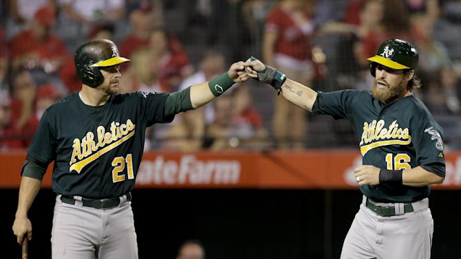 Athletics keep rolling, beat Angels 10-5
