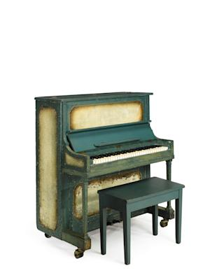 "This undated photo provided by Sotheby's shows the piano used in the movie ""Casablanca.""  An unidentified buyer plunked down $602,500 for the piano that played ""As Times Goes By"" in the classic 1942 film ""Casablanca.""  The 58-key upright sold at Sotheby's New York on Friday. (AP Photo/Sotheby's)"