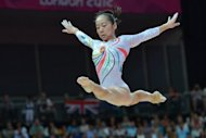China's Deng Linlin during the women's beam competition at the London Olympics on August 7. Deng and her compatriot Sui Lu picked up gold and silver in the women's balance beam final