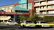 Two bodies could be seen near entrance of the Executive Hotel and Conference Centre in Burnaby, B.C., east of Vancouver, after a shooting on Monday morning.