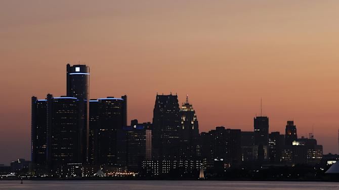 The sun sets on Detroit, Thursday, July 18, 2013. State-appointed emergency manager Kevyn Orr asked a federal judge permission to place Detroit into Chapter 9 bankruptcy protection Thursday. (AP Photo/Paul Sancya)