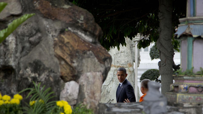 U.S. President Barack Obama, left, tours the Wat Pho Royal Monastery with Chaokun Suthee Thammanuwat, Dean, Faculty of Buddhism Assistant to the Abbot of Wat Phra Chetuphon, right, in Bangkok, Thailand, Sunday, Nov. 18, 2012. (AP Photo/Carolyn Kaster)