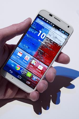 The Motorola Moto X smartphone, using Google's Android software, is shown, Thursday, Aug. 1, 2013 at a press preview in New York. (AP Photo/Mark Lennihan)