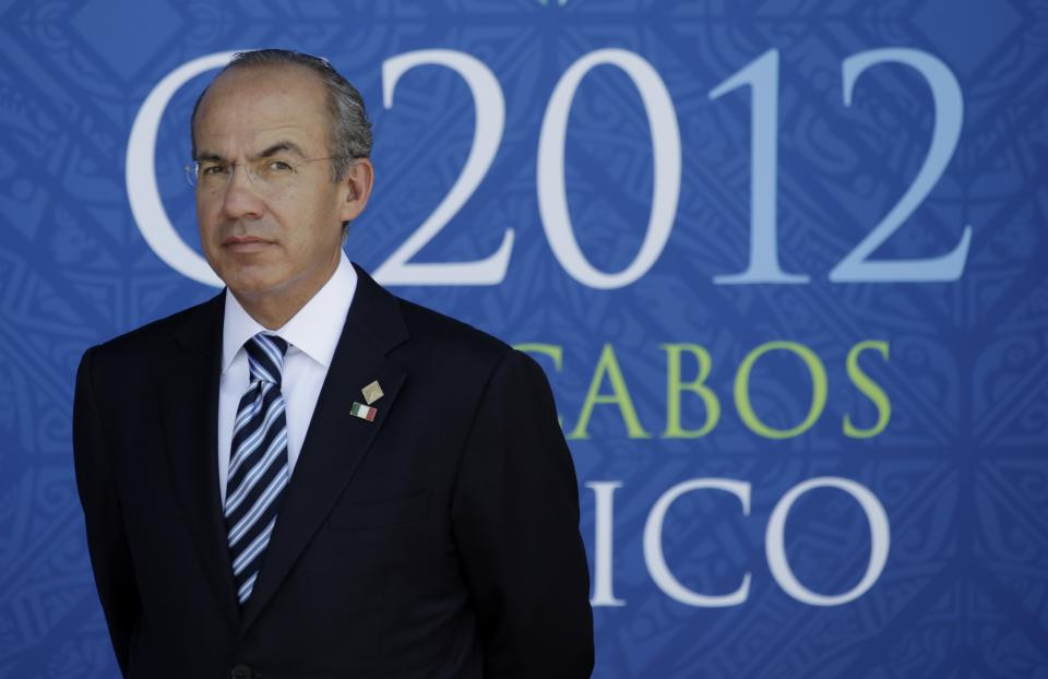 Mexico's President Felipe Calderon arrives for the the opening session of the G20 summit in Los Cabos, Mexico, Monday, June 18, 2012. (AP Photo/Eduardo Verdugo)
