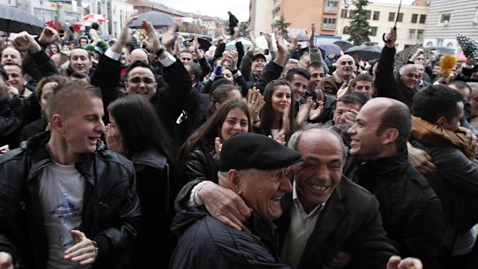 Supporters of the former Kosovo Prime Minister Ramush Haradinaj react after the verdict at the courtroom of the Yugoslav war crimes tribunal in The Hague was announced on a giant screen in capital Pristina on Thursday, Nov. 29, 2012. A U.N. war crimes tribunal has acquitted the former prime minister of Kosovo and two of his former Kosovo Liberation Army comrades for the second time on charges murdering and torturing Serbs and their supporters in Kosovo's war for independence. ( AP Photo/Visar Kryeziu)