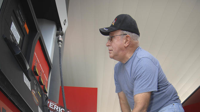 John Handzus fills extra jugs with gasoline at a gas station in Fort Walton Beach, Fla., Saturday August 25, 2012 in preparation for Tropical Storm Isaac which is forecasted to make landfall in the Florida Panhandle as a hurricane on Tuesday. (AP Photo/Northwest Florida Daily News, Nick Tomecek)