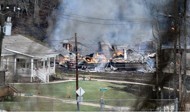 The remains of a residential structure is leveled and burning after a natural gas line explosion Tuesday afternoon  Dec. 11, 2012 along Route 21 in between Sissonville, W.V. and Pocatalico, W.V.  At l