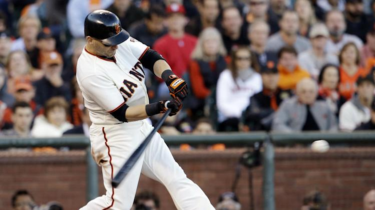 San Francisco Giants' Marco Scutaro hits a two-run double during the second inning of Game 6 of baseball's National League championship series against the St. Louis Cardinals Sunday, Oct. 21, 2012, in San Francisco. (AP Photo/David J. Phillip)