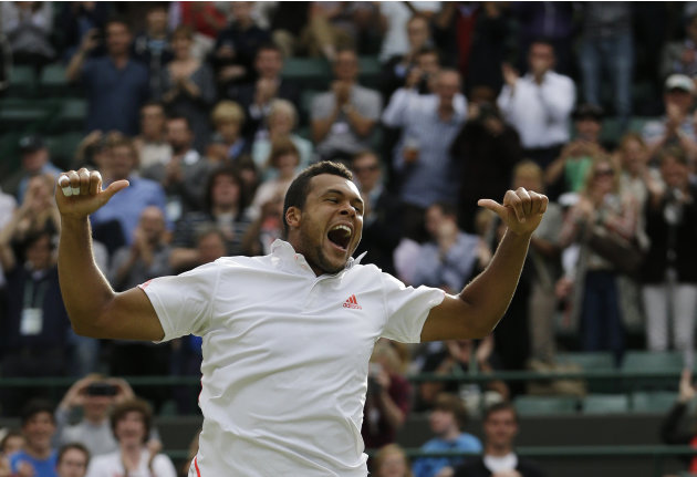 Jo-Wilfried Tsonga of France reacts after defeating Philipp Kohlschreiber of Germany during a quarterfinals match at the All England Lawn Tennis Championships at Wimbledon, England, Wednesday, July 4,