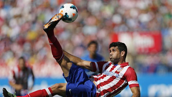 In this Sept. 14, 2013 file photo, Atletico de Madrid's Diego Costa tries an overhead kick on goal during a Spanish La Liga soccer match against Almeria at the Vicente Calderon stadium in Madrid. Costa has sent a letter to the Brazilian football federation and FIFA it was announced Tuesday Oct. 29, 2013 saying his intention is to play for his adopted Spain. Costa was born in Brazil but holds a Spanish passport. He has not played an official match for Brazil, leaving him free to declare his allegiance with his adopted country. The Spanish federation says national coach Vicente del Bosque plans to select Costa for friendlies in Angola on Nov. 15 and in South Africa on Nov. 19