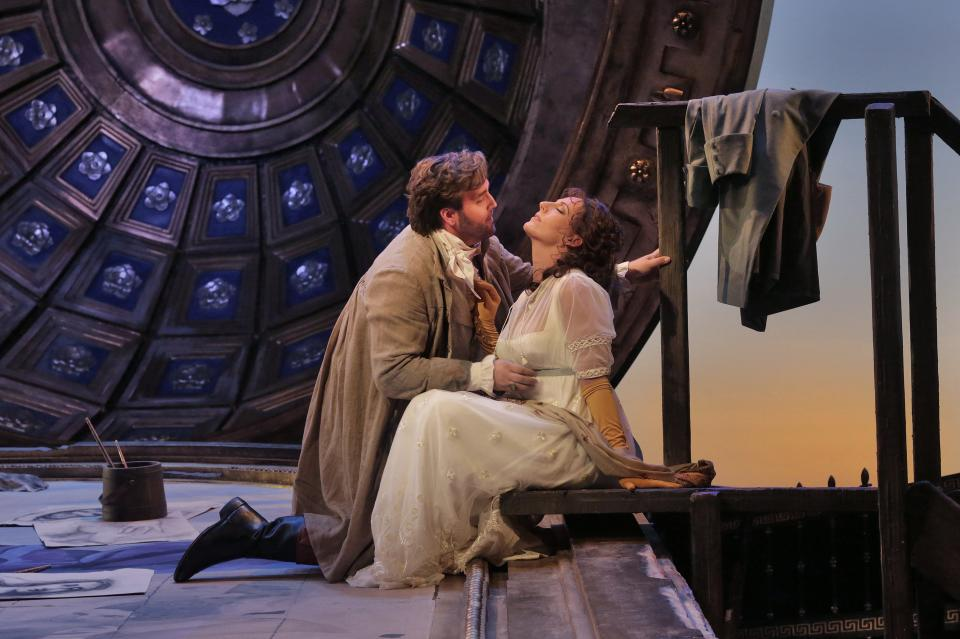 "In this undated photo provided by the Santa Fe Opera, Brian Jagde, left, and Amand Echalaz perform in the Santa Fe Opera production of Puccini's ""Tosca."" (AP Photo/Santa Fe Opera, Ken Howard)"