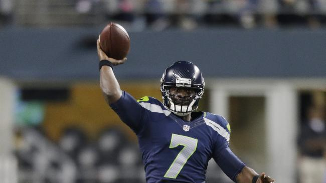 Seattle Seahawks quarterback Tarvaris Jackson throws against the Chicago Bears in the second half of a preseason NFL football game, Friday, Aug. 22, 2014, in Seattle