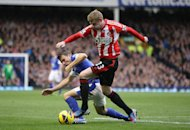 James McClean, right, chose not to wear a Remembrance Day poppy against Everton on Saturday