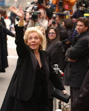 FILE - This March 16, 2002 file photo shows actress Lauren Bacall waving as she enters Marble Collegiate Church in New York for the wedding of Liza Minnelli and David Gest. Bacall, the sultry-voiced actress and Humphrey Bogart's partner off and on the screen, died Tuesday, Aug. 12, 2014 in New York. She was 89. (AP Photo/Ed Betz, File)