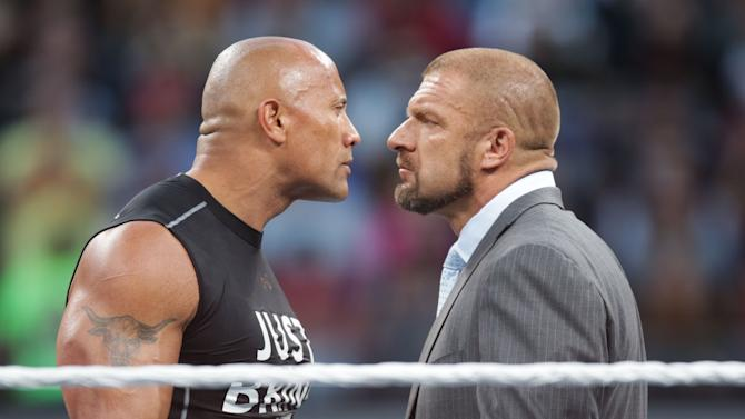 IMAGE DISTRIBUTED FOR WWE - Dwayne the Rock Johnson stares off against WWE superstar Triple H at WrestleMania 31 on Sunday, March 29, 2015 in Santa Clara, CA. WrestleMania broke the Levi's Stadium attendance record at 76,976 fans from all 50 states and 40 countries. (Don Feria/AP Images for WWE)