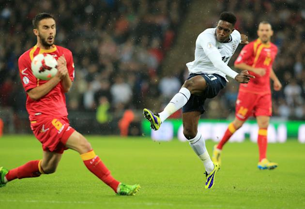 LONDON, Oct. 12, 2013 (Xinhua) -- Daniel Welbeck (C)of England shoots during the FIFA 2014 World Cup Qualifying match between England and Montenegro at Wembley Stadium in London, Britain on Oct. 11, 2