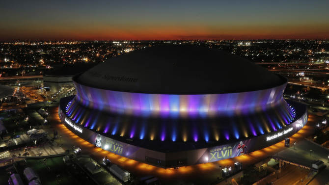 The Superdome, where the NFL Super Bowl XLVII football game between the San Francisco 49ers and Baltimore Ravens will be played, is seen at sunset Friday, Feb. 1, 2013, in New Orleans. (AP Photo/Charlie Riedel)