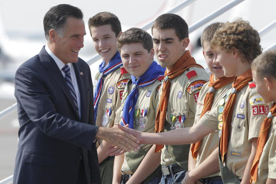 Republican presidential candidate and former Massachusetts Gov. Mitt Romney greets boy scouts as he arrives in Salt Lake City, Utah, Tuesday, Sept. 18, 2012.  (AP Photo/Charles Dharapak)