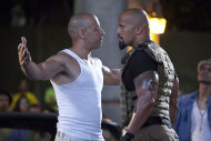 "In this film publicity image released by Universal Pictures, Vin Diesel, left, and Dwayne Johnson are shown in a scene from ""Fast Five."""