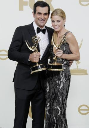 Ty Burrell, left, Julie Bowen from the television series  Modern Family hold their Emmys for best supporting actor and actress in a comedy, backstage at the 63rd Primetime Emmy Awards on Sunday, Sept. 18, 2011 in Los Angeles. (AP Photo/Jae Hong)
