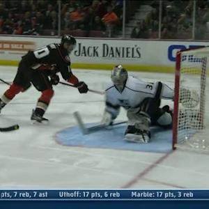 Corey Perry dekes around Jones to score