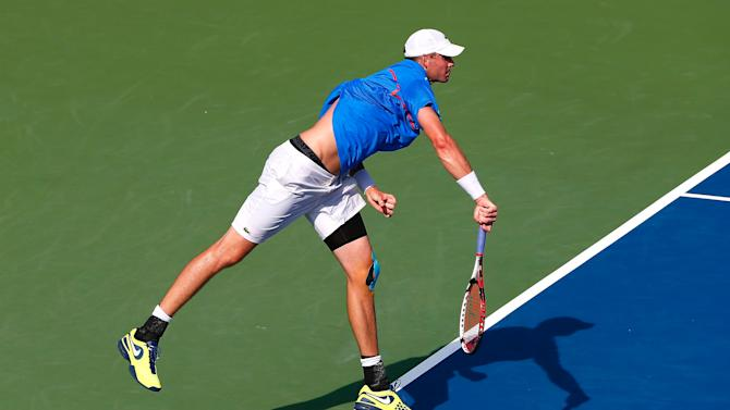 John Isner serves to Marinko Matosevic of Australia during the BB&T Atlanta Open at Atlantic Station on July 25, 2014 in Atlanta, Georgia