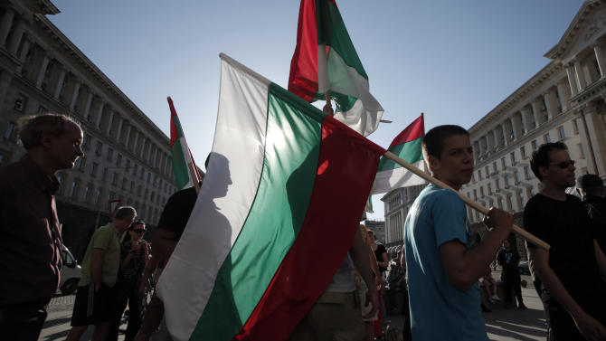 Demonstrators carry Bulgarian flags during a protest against the center-right GERB party in Sofia, Saturday, May 11, 2013.  Bulgarian prosecutors have stormed a printing house and seized  350,000 illegally printed ballots just hours before the start of parliamentary elections. Vote-buying and other election fraud concerns have prompted the Organisation for Security and Cooperation in Europe (OSCE) to dispatch its biggest monitoring mission to Bulgaria since 1990 for Sunday's vote. (AP Photo / Valentina Petrova)