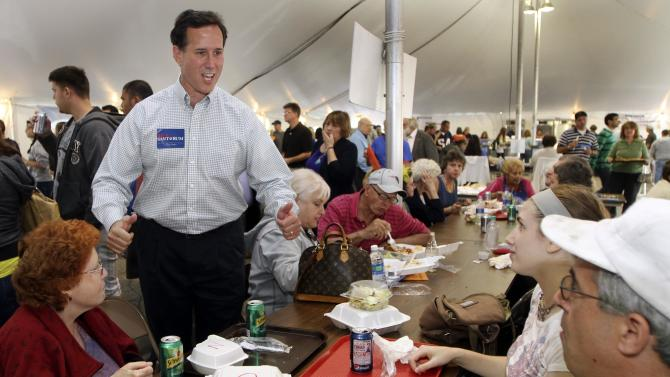 Republican presidential candidate, former  U.S. Sen., Rick Santorum of Pennsylvania during a campaign styop at the Greek Festival, Sunday, Sept. 18, 2011 in Manchester, NH (AP Photo/Jim Cole)