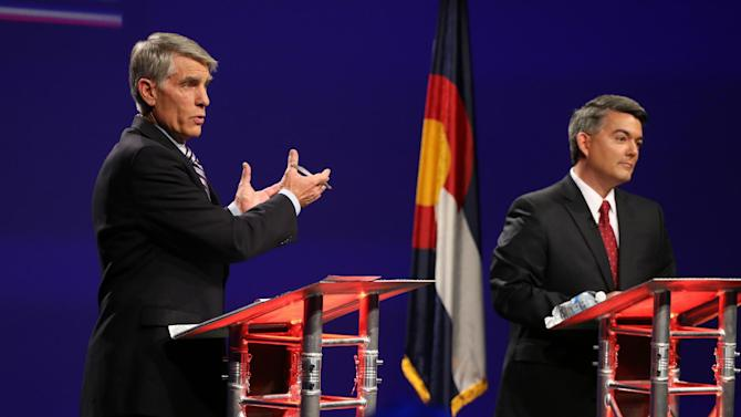 FILE - In this Oct. 15, 2014 file photo, Sen. Mark Udall, D-Colo., left, and his Republican opponent, Rep. Cory Gardner, R-Colo., face off during a televised debate at 9News in Denver. As a season of campaigning enters its final, intense weekend, a new Associated Press-GfK poll illustrates the challenge ahead for candidates and their allies trying to rally voters around traditional wedge issues such as abortion and gay marriage. This fall, voters just have other matters on their minds. (AP Photo/Brennan Linsley, File)