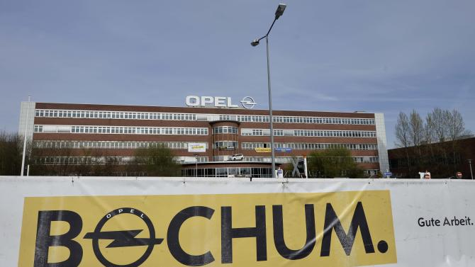 "A banner reading ""Bochum. Good work.""  is placed  in front of he Opel car plant in Bochum, Germany, Wednesday, April 17, 2013. General Motors' loss-making Opel division has confirmed it plans to end production at the plant in Germany by the end of 2014.   Adam Opel AG said Wednesday in a statement that the Bochum plant would wind down production as part of its plan to reduce costs and turn the division around. The plant's 3,200 workers make the Zafira compact. The plant's closure has been expected since workers there rejected a compromise restructuring that would have extended some production.  (AP Photo/Martin Meissner)"