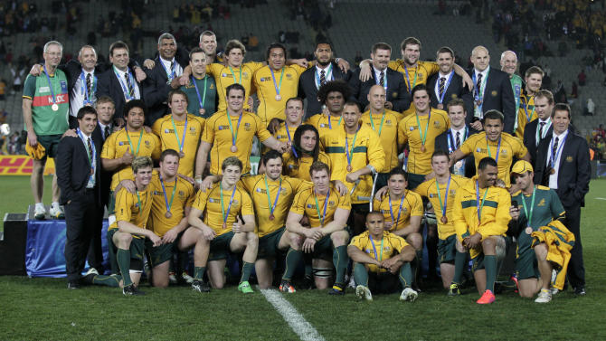 Australia team players and staff members pose with their medals after their bronze medal Rugby World Cup victory over Wales at Eden Park in Auckland, New Zealand, Friday, Oct. 21, 2011. (AP Photo/Mark Baker)