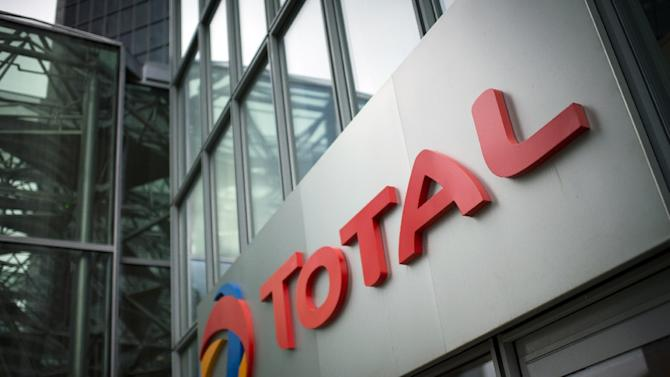 A picture shows the logo of French oil company headquarters Total, on October 21, 2014 in La Defense buisness district, near Paris. New chief executive promises stability after death of former chief in plane crash this month