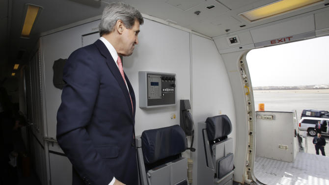 U.S. Secretary of State John Kerry walks out of his plane upon arrival in Cairo, Egypt on Saturday, March 2, 2013. Cairo is the sixth leg of Kerry's first official overseas trip and begins the Middle East portion of his nine-day journey. (AP Photo/Jacquelyn Martin, Pool)