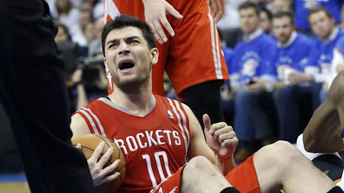 Houston Rockets forward Carlos Delfino reacts to a call in the third quarter of Game 2 in their first-round NBA basketball playoff series against the Oklahoma City Thunder in Oklahoma City, Wednesday, April 24, 2013. Oklahoma City won 105-102. (AP Photo/Sue Ogrocki)